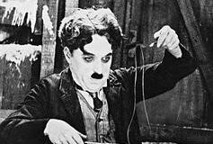 Charlie Chaplin eating shoe laces/licorice laces in the Gold Rush, 1925